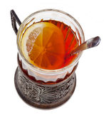 Tea with lemon in vintage glass with spoon Royalty Free Stock Photography
