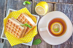 Tea with lemon and waffle royalty free stock photos