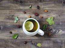 Tea with lemon on wooden background. Top view Stock Photos