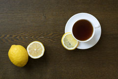 Tea with lemon on wooden board. Top view Stock Images