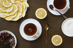Tea with lemon on wooden board Royalty Free Stock Photos