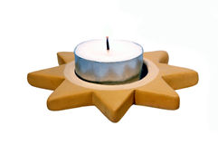 Tea light. Burning tea light (Candle) in the Christmas-star in front of white background Royalty Free Stock Images