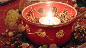 Tea Light burning in ceramic bowl at Christmas Royalty Free Stock Photography