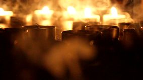 Tea Light Candles blow out. On dark background stock video footage