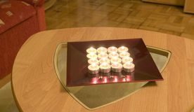 Tea-light candles on a table Stock Image