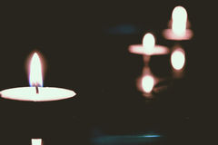 Tea light Moods. A row of tea light lit up in the dark Royalty Free Stock Image