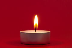 Tea Light on Red Stock Image