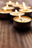 Tea lights. Spa or romantic concept with some small candles, selective focus on nearest Stock Photography