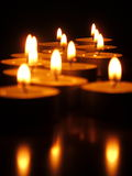 Tea Lights. Lit tea lights in the dark Royalty Free Stock Photo