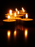 Tea Lights. Lit tea lights in the dark Royalty Free Stock Photography