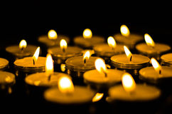 Tea lights. Ablaze for peace and serenity Royalty Free Stock Image