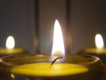 Tea lights or candles. Three small candles or tea lights Stock Images