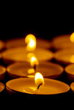 Tea lights candles with fire Stock Images