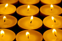 Tea lights candles with fire Royalty Free Stock Images