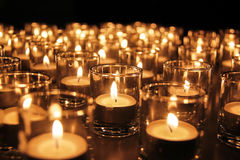 Tea lights in glass jars royalty free stock images