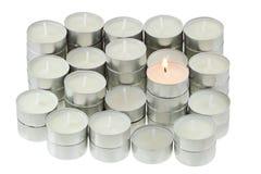 Tea lights isolated on white Stock Photo