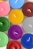 Tea lights. A lot of multicolor tea lights closeup as a background Stock Images