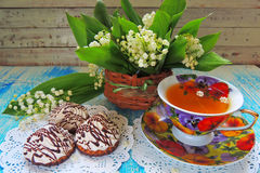 Tea and Lily of the valley Stock Photos