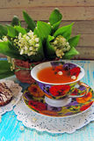 Tea and Lily of the valley Stock Image