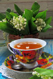 Tea and Lily of the valley Royalty Free Stock Photography