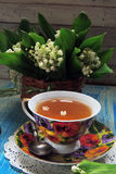 Tea and Lily of the valley Royalty Free Stock Photos