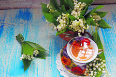 Tea and Lily of the valley Royalty Free Stock Photo