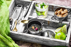 Tea with lime. Retro tray with herb tea,lime,ingredients and utensils Royalty Free Stock Images