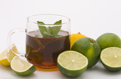 Tea and limes Royalty Free Stock Image