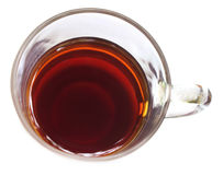 Tea liquor on a transparent cup Royalty Free Stock Image