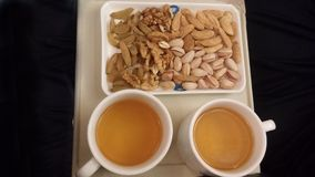 Tea and nuts. Tea with lots of mix nuts Royalty Free Stock Photography