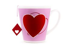 Tea of Love. Shot of the big cup with heart print and tea-label with symbol of love, on a white background with pretty shadow Stock Photo