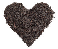 Tea love. Tea leaves in the form of heart isolated Stock Photos