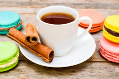 Tea with macaroon and cinnamon Stock Image