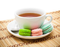 Tea and macaroon Stock Photos