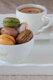 Tea and macaroons Stock Images