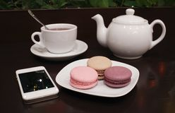 Tea and macaroons with a tablet computer Royalty Free Stock Photography