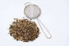 Tea made from basil with metal strainer Royalty Free Stock Images