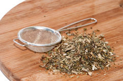 Tea made from basil with metal strainer Stock Images