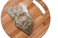 Tea made from basil in plastic bag on the wooden board Stock Photography