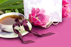Tea and magenta tulips with blank note Royalty Free Stock Photos