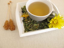 Tea with marigold and cornflower on tray. Herbal tea with marigold and cornflower on tray Stock Image