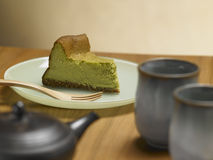 Tea Matcha cheese cake. On a wood background Stock Images