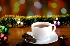 Tea med godisar Arkivbild