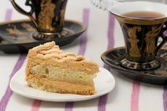Tea med tårtan Arkivbilder
