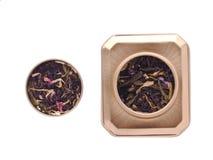 Tea in metal box. Tea in metal golden tea box isolated on white stock photography
