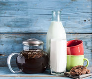 Tea and milk on old wood background Stock Photo
