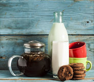 Tea and milk on old wood background Stock Photography