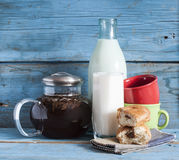 Tea and milk on old wood background Royalty Free Stock Photography