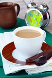 Tea with milk in a white cup Stock Photos