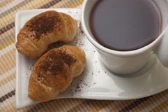 Tea and mini croissants. With chocolate crumbs Stock Photography